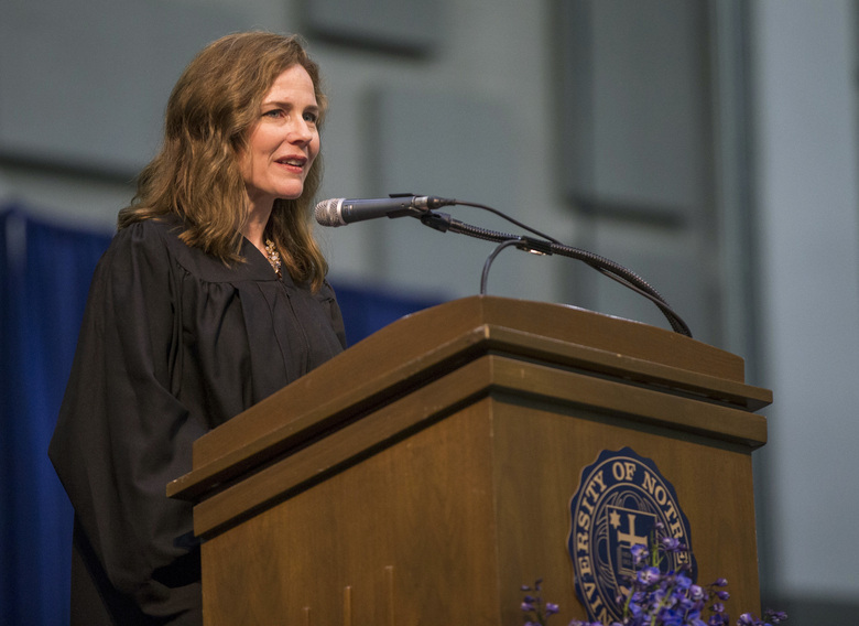Judge Amy Coney Barrett, of the U.S. Court of Appeals for the Seventh Circuit, speaks May 19, 2018, at the University of Notre Dame's Law School commencement ceremony in South Bend, Ind. Barrett has established herself as a reliable conservative on hot-button legal issues from abortion to gun control. (Robert Franklin/South Bend Tribune via AP, File)