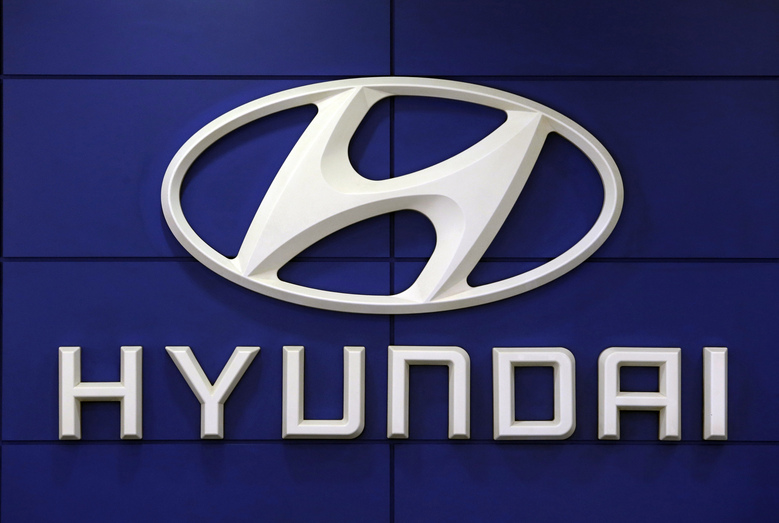 FILE – In this July 26, 2018 file photo, the logo of Hyundai Motor Co. is seen at its showroom in Seoul, South Korea. For the second time this month, Hyundai is telling some SUV owners to park outdoors because an electrical short in a computer can cause vehicles to catch fire. The Korean automaker is recalling about 180,000 Tucson SUVs in the U.S. from 2019 through 2021 to fix the problem.  (AP Photo/Ahn Young-joon, File)