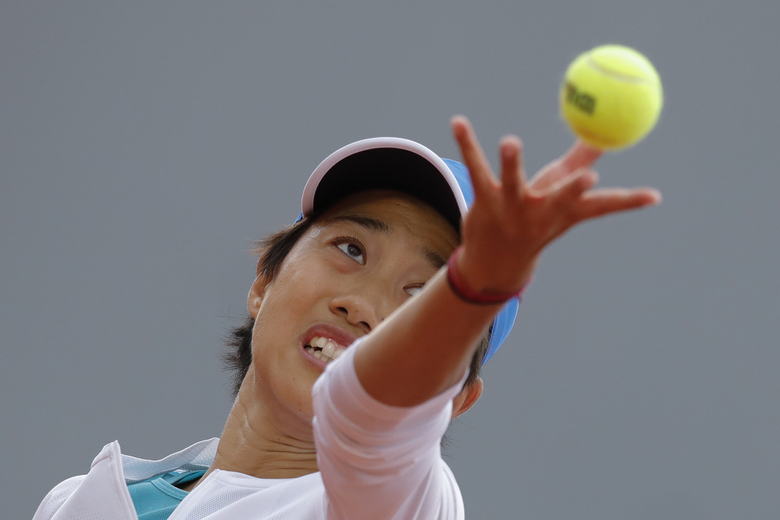 China's Zhang Shuai serves against Madison Keys of the U.S. in the first round match of the French Open tennis tournament at the Roland Garros stadium in Paris, France, Monday, Sept. 28, 2020. (AP Photo/Christophe Ena)