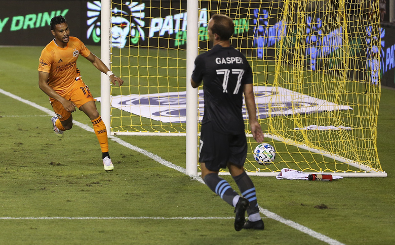 Houston Dynamo forward Ariel Lassiter (11) scores a goal against Minnesota United during the second half of an MLS soccer match Wednesday, Sept. 2, 2020, in Houston. (Yi-Chin Lee/Houston Chronicle via AP)