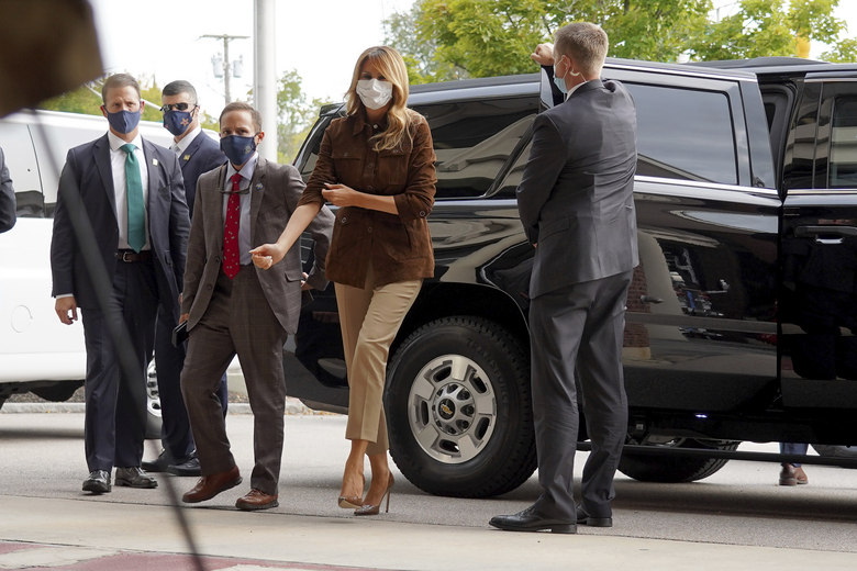 First lady Melania Trump adjust her sleeve as she stops for a visit at the Manchester Fire Department Central Station, Thursday, Sept. 17, 2020, in Manchester, N.H. (AP Photo/Mary Schwalm)