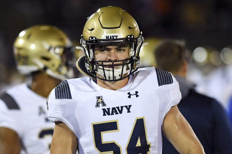 FILE – Navy linebacker Diego Fagot (54) gets ready to go in during the first half of an NCAA college football game against Connecticut, Friday, Nov. 1, 2019, in East Hartford, Conn. The key to the Navy defense is 6-foot-3, 240-pound linebacker Diego Fagot, who led the Midshipmen with 100 tackles last year as a sophomore. (AP Photo/Stephen Dunn, File)