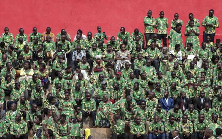 """FILE – In this Thursday, June 18, 2020 file photo, supporters sit in the stands as they attend the inauguration of Burundi's President Evariste Ndayishimiye in Gitega, Burundi. A new report released Thursday, Sept. 17, 2020 by the United Nations commission of inquiry on Burundi sees little optimism in the government of new President Evariste Ndayishimiye, saying it is """"extremely concerned"""" that he has appointed senior officials who face international sanctions for alleged human rights abuses in the country's 2015 political turmoil. (AP Photo/Berthier Mugiraneza, File)"""