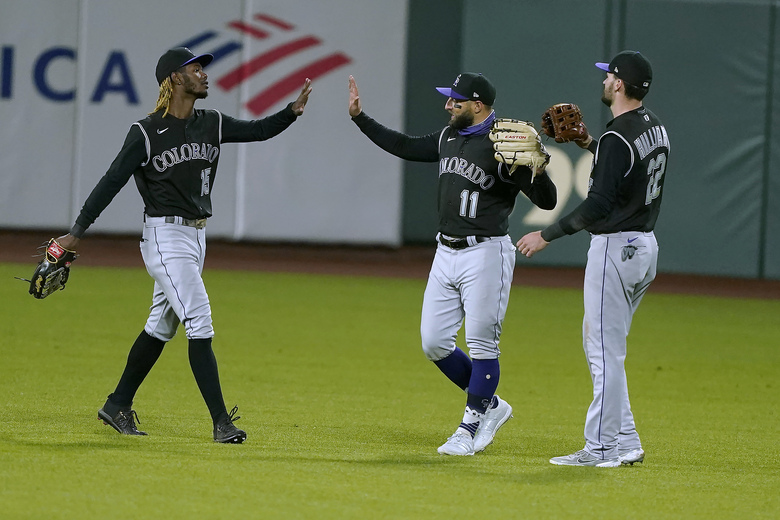 Colorado Rockies left fielder Raimel Tapia (15), center fielder Kevin Pillar (11) and right fielder Sam Hilliard (22) celebrate after a 7-2 victory against the San Francisco Giants in a baseball game on Monday, Sept. 21, 2020, in San Francisco. (AP Photo/Tony Avelar)
