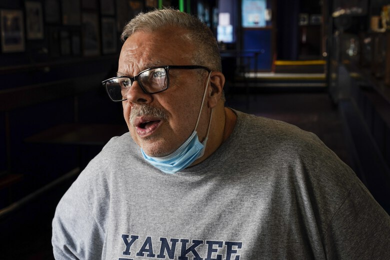 Joe Bastone, owner of Yankee Tavern, responds to questions during an interview Friday, Aug. 14, 2020, in New York. Bastone is expecting to lose about $500,000 in revenue this season — losses unlike anything the 93-year-old bar has previously survived. (AP Photo/Frank Franklin II)