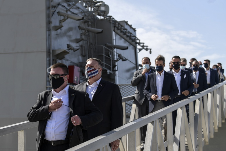 US Secretary of State Mike Pompeo and Greek Prime Minister Kyriakos Mitsotakis visit the Greek frigate Salamis at the Naval Support Activity base at Souda, on the Greek island of Crete, Tuesday, Sept. 29, 2020. Pompeo visited a U.S. naval base at Souda Bay on the southern Greek island of Crete Tuesday, ahead of a meeting with Greece's prime minister on the second day of his trip to the country. (Aris Messinis/Pool viaAP)