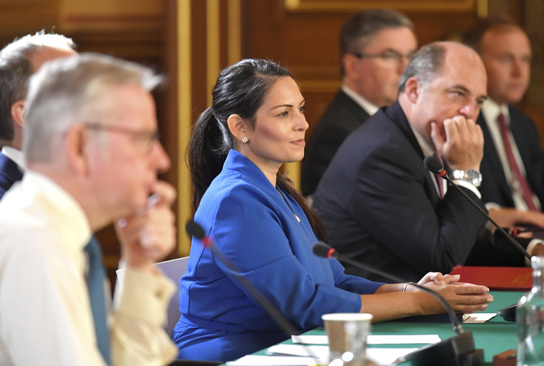 Britain's Home Secretary Priti Patel attends a Cabinet meeting of senior government ministers at the Foreign and Commonwealth Office FCO in London, Tuesday Sept. 1, 2020. (Toby Melville/Pool via AP)