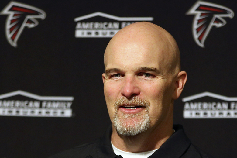 FILE – In this Dec. 15, 2019, file photo, Atlanta Falcons head coach Dan Quinn speaks at a news conference after an NFL football game against the San Francisco 49ers in Santa Clara, Calif. The heat is on — and the games haven't even kicked off yet. That's life in the NFL for some coaches who enter the regular season knowing they need to guide their squads through what will be a most unusual regular season and at least keep them in playoff contention into December. (AP Photo/John Hefti, File)