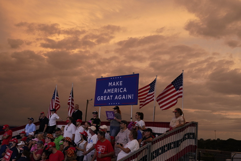 People cheer as President Donald Trump speaks during a campaign rally at Smith Reynolds Airport, Tuesday, Sept. 8, 2020, in Winston-Salem, N.C. (AP Photo/Evan Vucci)