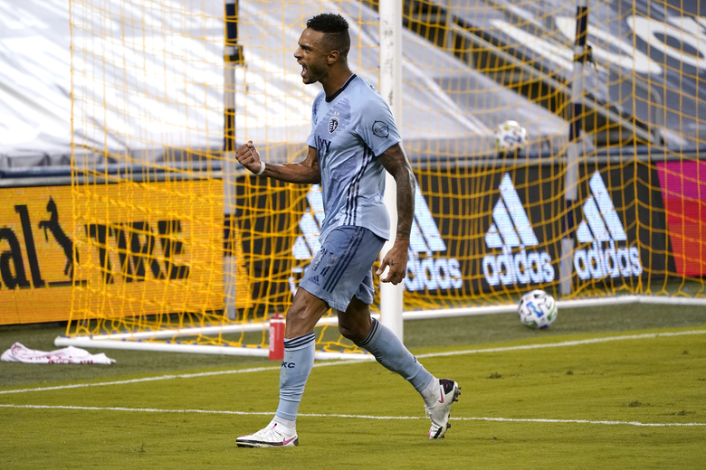 Sporting Kansas City forward Khiry Shelton celebrates after scoring a goal during the first half of an MLS soccer match against FC Dallas Wednesday, Sept. 2, 2020, in Kansas City, Kan. (AP Photo/Charlie Riedel)