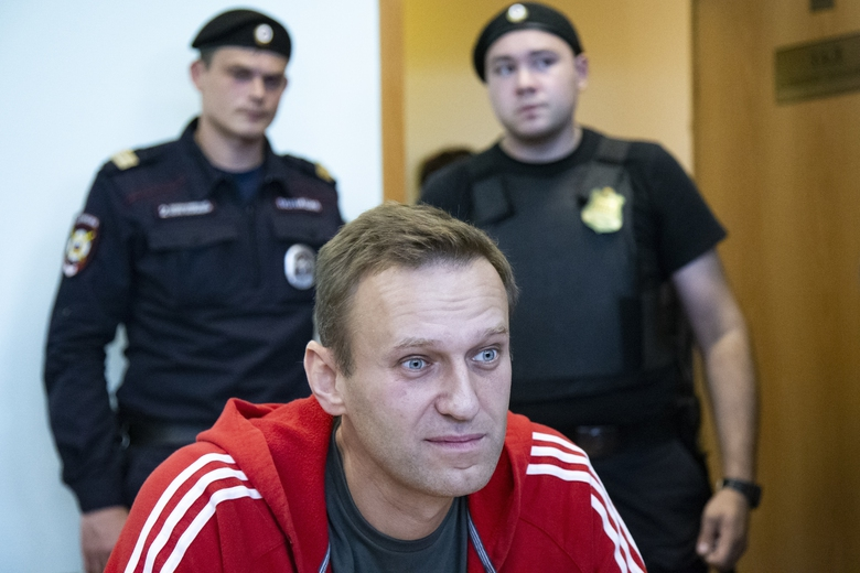 """FILE In this file photo taken on Thursday, Aug. 22, 2019, Russian opposition leader Alexei Navalny speaks to the media prior to a court session in Moscow, Russia. German Chancellor Angela Merkel says Russian opposition leader Alexei Navalny was the victim of an """"attempted murder by poisoning"""" and the aim was to silence him. Navalny was poisoned with the same type of Soviet-era nerve agent that British authorities identified in a 2018 attack on a former Russian spy, the German government said Wednesday, Sept. 2, 2020 citing new test results.  (AP Photo/Alexander Zemlianichenko, File)"""
