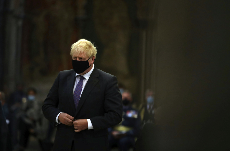Britain's Prime Minister Boris Johnson looks on during a service to mark the 80th anniversary of the Battle of Britain at Westminster Abbey, London, Sunday, Sept. 20, 2020. (Aaron Chown/Pool Photo via AP)