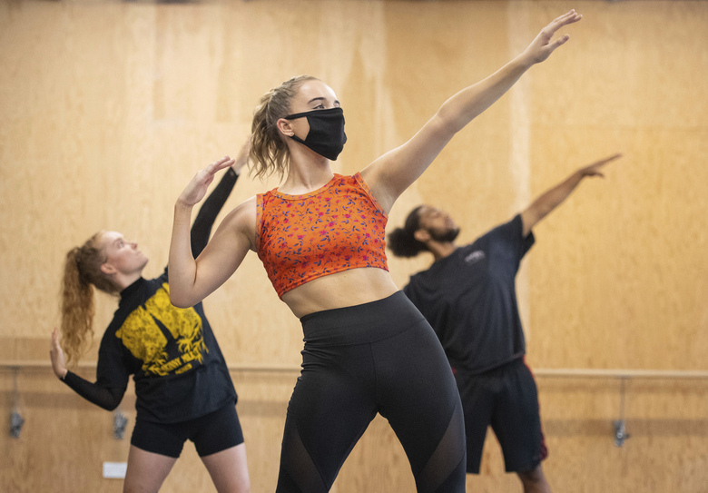 Students observe social distancing as they take part in a dance session as classes resume at Mountview Academy of Theatre Arts drama school following its closure due to coronavirus, in Peckham, south London, Tuesday, Sept. 8, 2020. (Dominic Lipinski/PA via AP)