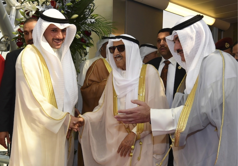 FILE – In this Wednesday, Oct. 16, 2019 file photo released by Kuwait News Agency, KUNA, Emir of Kuwait Sheikh Sabah al-Ahmad al-Sabah, middle, receives by Kuwaiti officials after his arrival from the U.S. in Kuwait. Kuwait state television said Tuesday, Sept. 29, 2020, the country's 91-year-old ruler, Sheikh Sabah Al Ahmad Al Sabah, had died. ( KUNA via AP, File)