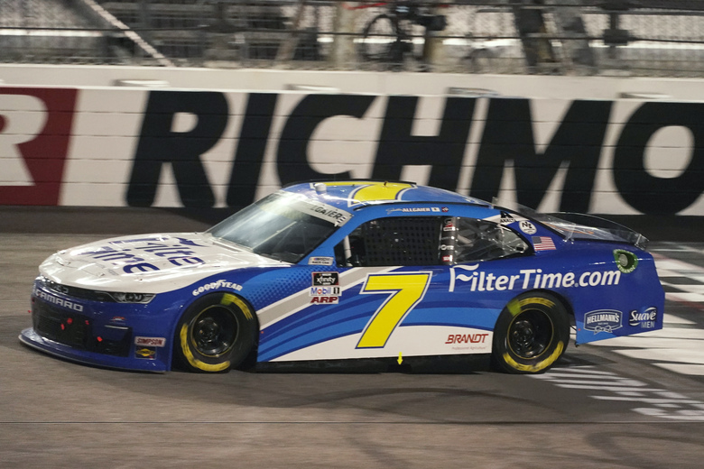 Justin Allgaier leads the field at the start of the third stage during the NASCAR Xfinity Series auto race Friday, Sept. 11, 2020, in Richmond, Va. (AP Photo/Steve Helber)