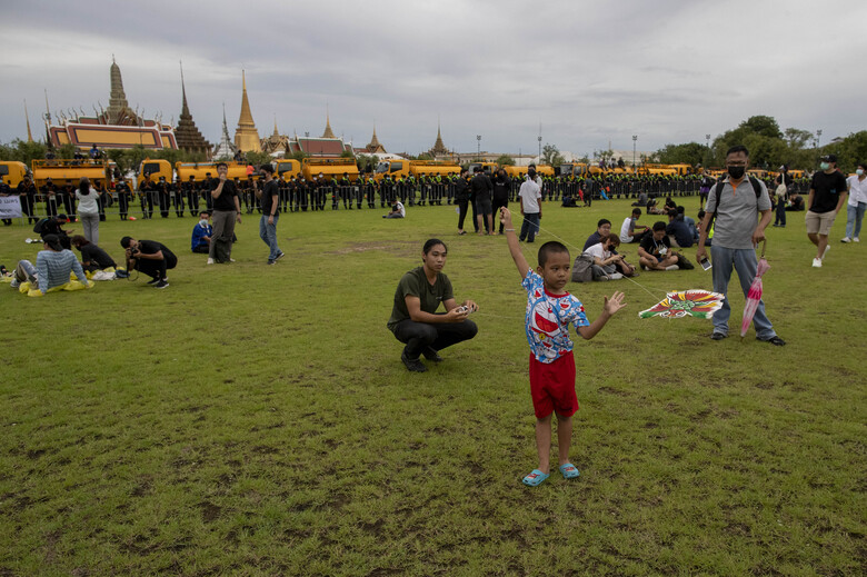 A child flies a kite during a pro-democracy rally at Sanam Luang in Bangkok, Thailand, Saturday, Sept. 19, 2020. Protesters gathered Saturday in Bangkok for the most ambitious rally so far in a pro-democracy campaign that has shaken up the government and the country's conservative establishment. (AP Photo/Gemunu Amarasinghe)
