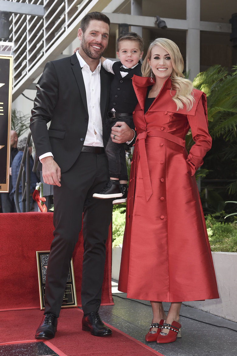 "FILE – In this Sept. 20, 2018 file photo, singer Carrie Underwood poses with her husband Mike Fisher, and their son Isaiah Michael Fisher as they attend a ceremony honoring Underwood with a star on the Hollywood Walk of Fame, in Los Angeles.  Underwood's son provided the adorable vocals on ""Little Drummer Boy,"" one of the 11 tracks on the country superstar's new Christmas album, ""My Gift,"" out Friday, Sept. 25, 2020.  (Photo by Richard Shotwell/Invision/AP, File)"