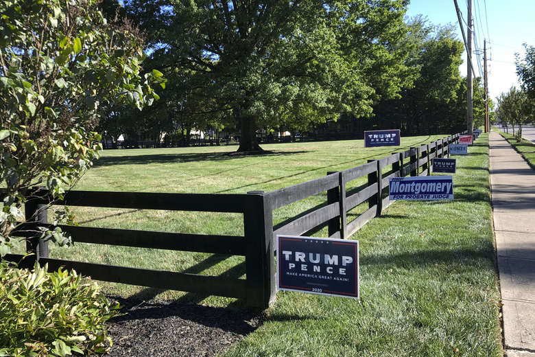 Signs in support of President Donald Trump and other Republican candidates on a lawn of a suburban Dublin, Ohio, home on Friday, Sept. 18, 2020. (AP Photo/Julie Carr Smyth)