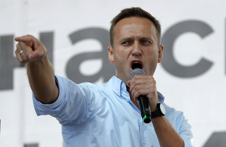 FILE – In this July 20, 2019, file photo, Russian opposition activist Alexei Navalny gestures while speaking to a crowd during a political protest in Moscow, Russia. The German hospital treating Russian opposition leader Alexei Navalny says he has been taken out of an induced coma and is responsive. German experts say Navalny, who fell ill Aug. 20 on a domestic flight in Russia, was poisoned with a substance belonging to the Soviet-era nerve agent Novichok.  (AP Photo/Pavel Golovkin, File)