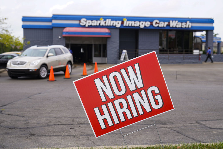 FILE – In this Sept. 2, 2020, file photo, a help wanted sign is displayed at car wash in Indianapolis. The Labor Department reported unemployment numbers Thursday, Sept. 3. (AP Photo/Michael Conroy, File)