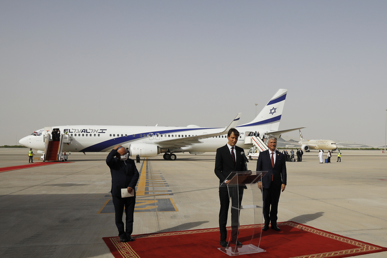 """FILE – In this Aug. 31, 2020 file photo, U.S. President Donald Trump's senior adviser Jared Kushner, center, speaks as Israeli National Security Advisor Meir Ben-Shabbat, left, and U.S. National Security Advisor Robert O'Brien stand by after an El Al plane from Israel landed in Abu Dhabi, United Arab Emirates.  For the first time in more than a quarter-century, a U.S. president will host a signing ceremony, Tuesday, Sept. 15, between Israelis and Arabs at the White House, billing it as an """"historic breakthrough"""" in a region long known for its stubborn conflicts. (Nir Elias/Pool Photo via AP, File)"""
