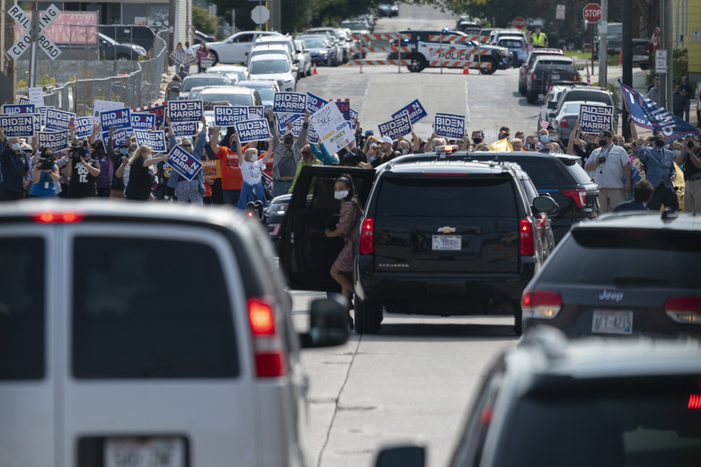 Supporters of Democratic presidential candidate former Vice President Joe Biden cheer as a motorcade with Biden aboard arrives at Wisconsin Aluminum Foundry in Manitowoc, Wis., Monday, Sept. 21, 2020. (AP Photo/Carolyn Kaster)
