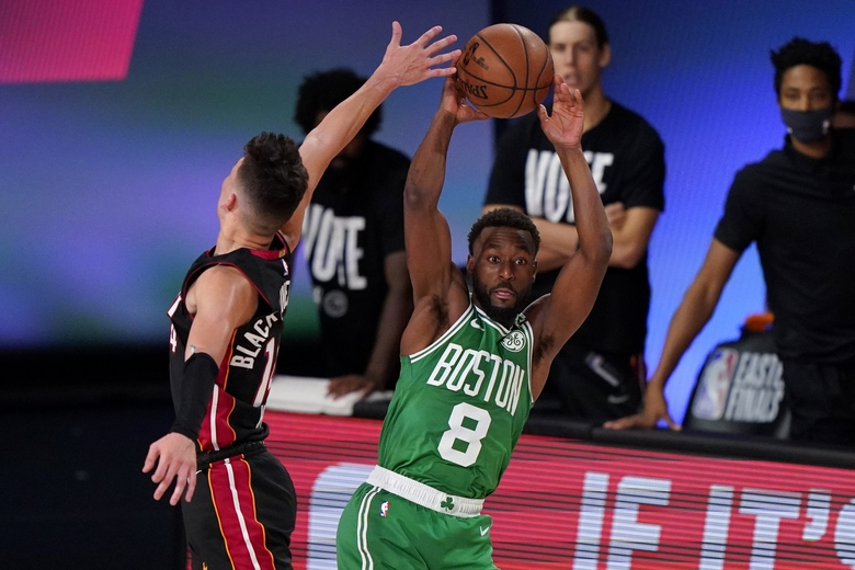 Miami Heat guard Tyler Herro (14) attempts to block a pass by Boston Celtics' Kemba Walker (8) during the first half of Game 4 of an NBA basketball Eastern Conference final, Wednesday, Sept. 23, 2020, in Lake Buena Vista, Fla. (AP Photo/Mark J. Terrill)