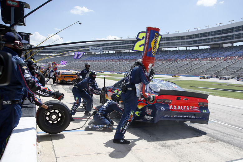 FILE – William Byron makes a pit stop during a NASCAR Cup Series auto race at Texas Motor Speedway in Fort Worth, Texas, Sunday, July 19, 2020. NASCAR has built itself around its traveling show, every weekend a super-charged event of concerts, camping and infield carousing that closes with a Cup race. The party has been canceled during the pandemic but the playoffs go on, starting Sunday, Sept. 6, without any of the pomp and circumstance. (AP Photo/Ray Carlin, File)