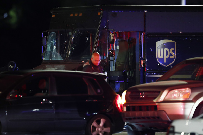 FILE – In this Dec. 5, 2019, file photo, authorities investigate the scene of a shooting in Miramar, Fla., that left four people, including a UPS driver, dead. The family of Frank Ordonez the UPS driver slain during the police shootout, have filed a lawsuit Wednesday, Sept. 16, 2020, against several law enforcement agencies. The say that officers acted negligently when they opened fire on two robbers who were holding him hostage inside his van. (AP Photo/Brynn Anderson, File)