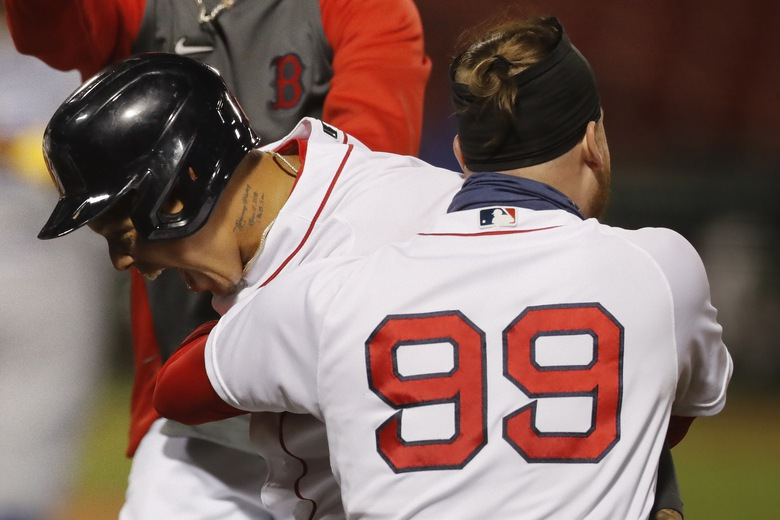 Boston Red Sox's Yairo Munoz, left, celebrates with Alex Verdugo (99) after driving in the winning run during the ninth inning of the team's baseball game against the Toronto Blue Jays, Saturday, Sept. 5, 2020, in Boston. (AP Photo/Michael Dwyer)