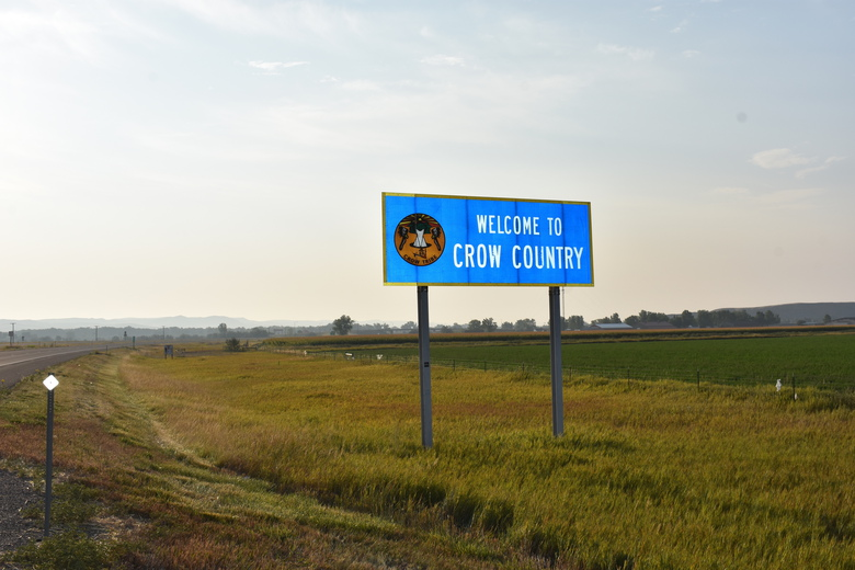 A sign marking the boundary of the Crow Indian Reservation stands near Hardin, Mont. on Wednesday, Aug. 26, 2020. U.S. Census officials are struggling to get an accurate count of households on the reservation that covers an area bigger than Delaware. (AP Photo/Matthew Brown)