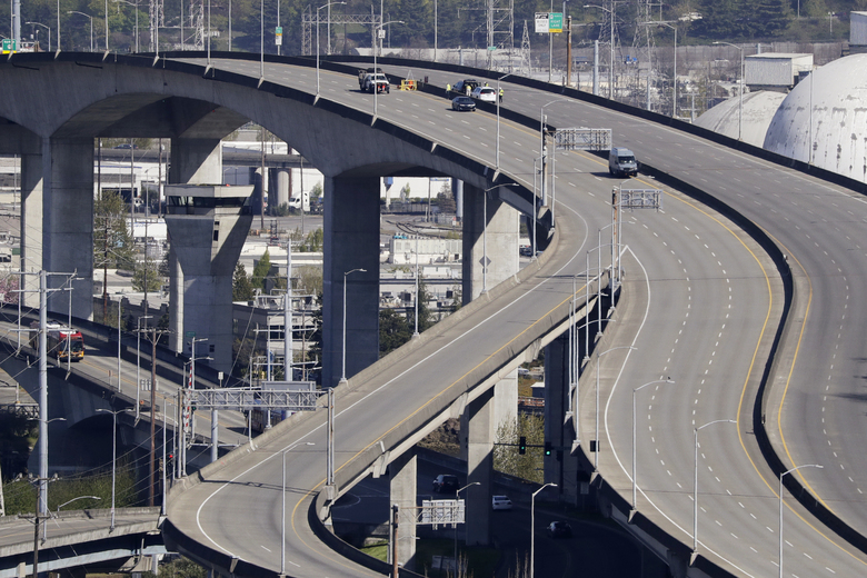 """The West Seattle Bridge was closed in the spring due to cracking. A new city audit found only 22 of the city's 77 bridges are in """"good"""" condition. (AP Photo / Elaine Thompson, File)"""