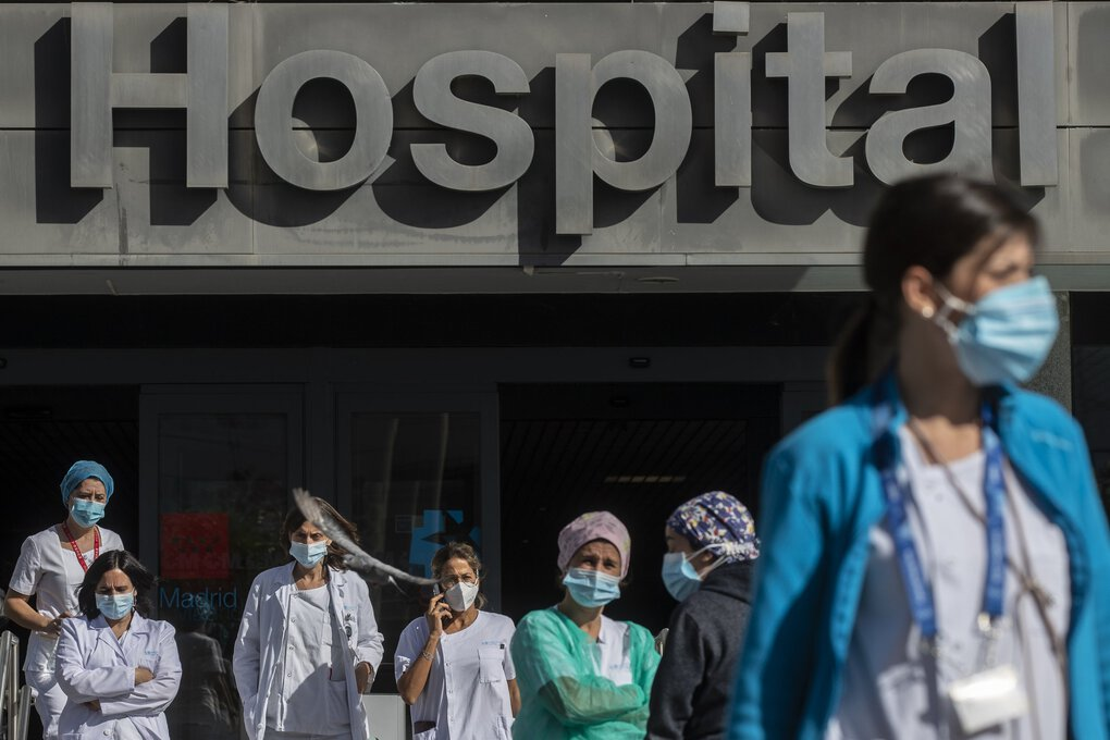 Medical staff gather during a protest demanding an improvement in wages and labor conditions at La Paz hospital in Madrid, Spain, the source of Europe's most worrying surge of infections in the second wave of the pandemic.  (Manu Fernandez / The Associated Press)