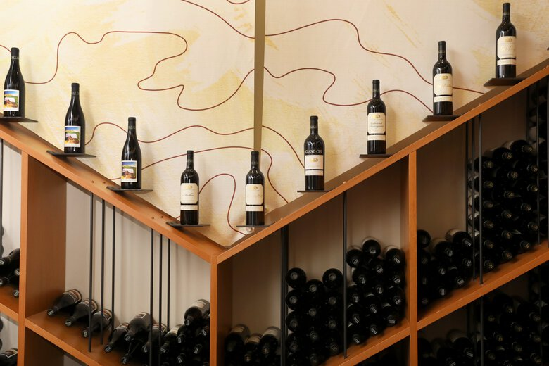 A display of bottles lines the new Hollywood Station tasting room at DeLille Cellars in Woodinville. (Ken Lambert / The Seattle Times)