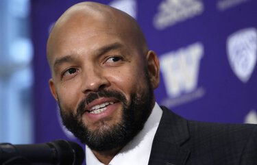 FILE – In this Dec. 3, 2019, file photo, Washington NCAA college football defensive coordinator Jimmy Lake speaks during a news conference about taking over the head coaching position, in Seattle. Just when it seemed like things were up and rolling, the COVID-19 pandemic hit. The ensuring national shutdown hurt coaches across college football as they prepare for next season, but it was particularly difficult on programs with first-year coaches trying to build something from the ground up. (AP Photo/Elaine Thompson, File)