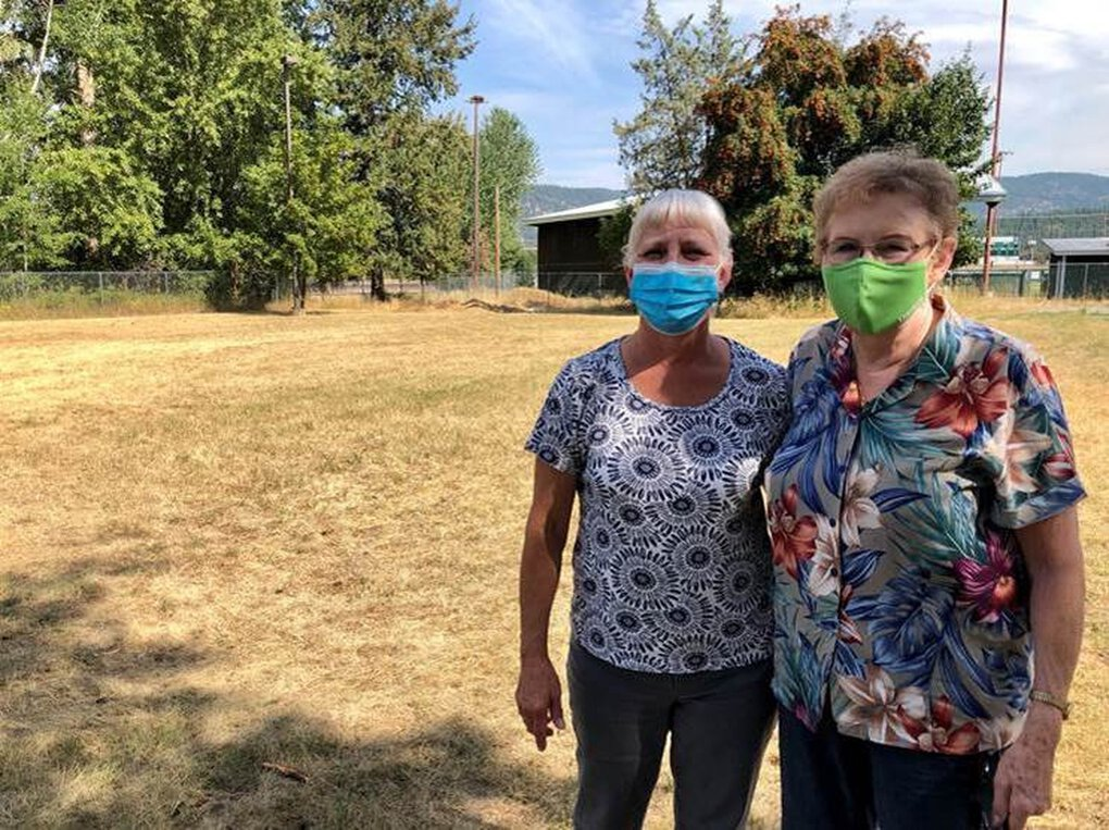 """Julie Kendall and her mother, Ellen Adkins, both have asbestos-related diseases and fear contracting the COVID-19 virus. Kendall, a phlebotomist at a local hospital, dislikes Libby's summer crowds. """"These people that come to these events from out of town are going to our gas stations and our grocery stores,"""" she says. """"They could be exposing you right there."""" (Nate Hegyi)"""
