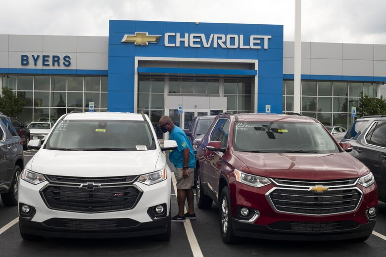 A customer views the interior of a General Motors Chevrolet SUV displayed for sale at a car dealership in Grove City, Ohio. SUVs and trucks are dominating U.S. auto sales like never before as carmakers start to recover from the biggest shock to their industry in decades. (Ty Wright / Bloomberg)