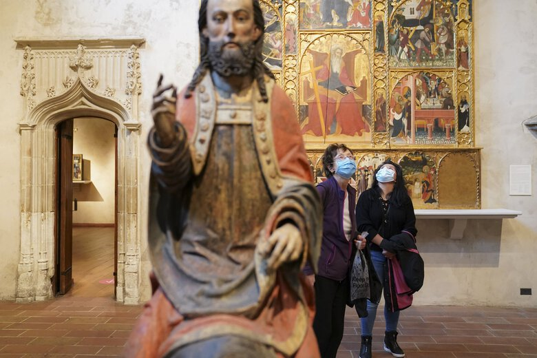 Visitors observe COVID-19 prevention protocols at The Met Cloisters, a branch of the Metropolitan Museum of Art dedicated to medieval European art on Friday in New York. (John Minchillo / Associated Press)