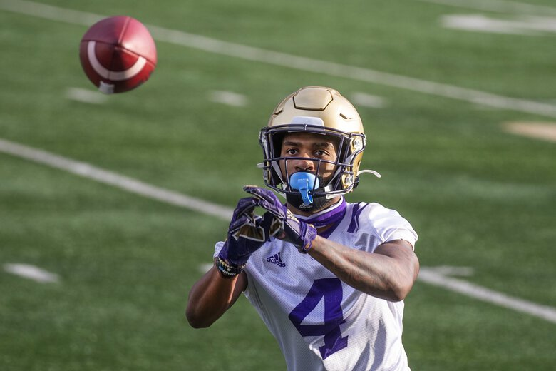 Husky wide receiver Terrell Bynum works out as the University of Washington Huskies practice at Husky Stadium on Friday October 9, 2020.  215315 (Mike Siegel / The Seattle Times)
