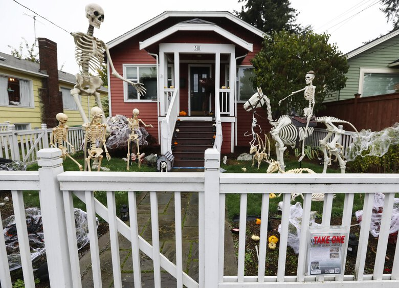 The Halloween scare is out at Seattle homes including this one in Greenwood, photographed Oct. 18. (Ken Lambert / The Seattle Times)