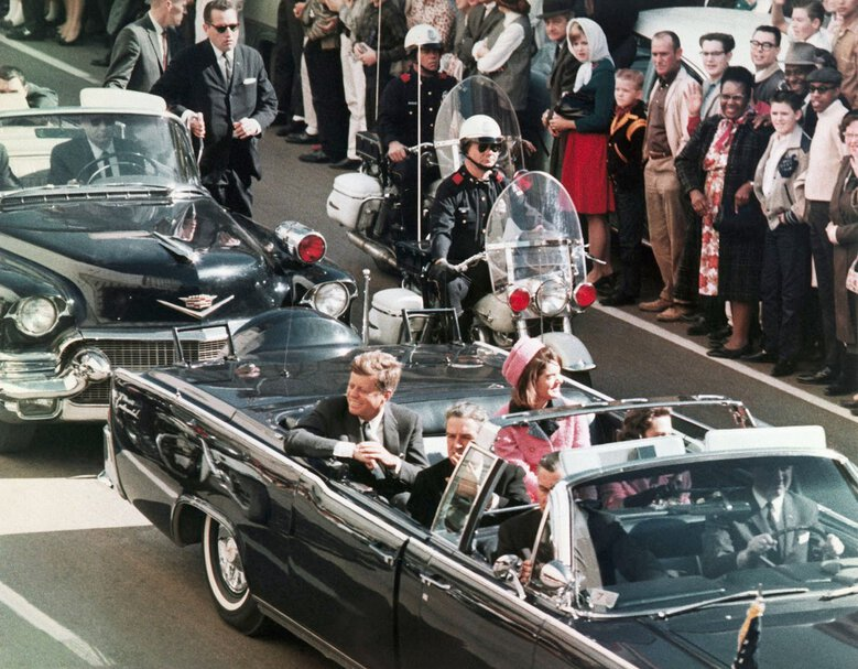 President John F. Kennedy's motorcade travels through Dallas on Nov. 22, 1963, the day he was assassinated. (The Associated Press / PRNewsFoto / Newseum)