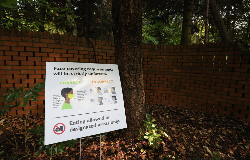 Signage clearly points out face mask rules at Woodland Park Zoo in Seattle. The zoo has carved out time each Wednesday for people who can't wear masks. (Alan Berner / The Seattle Times)