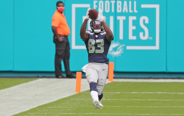 Seattle Seahawks wide receiver David Moore (83) on a long reception in the third quarter against the Miami Dolphins on Sunday, Oct. 4, 2020 at Hard Rock Stadium in Miami Gardens, Florida.  (Charles Trainor Jr. / TNS)