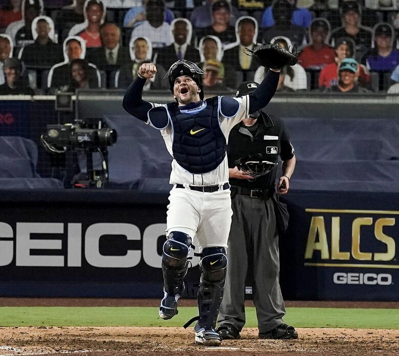Tampa Bay Rays catcher Mike Zunino celebrates a victory in Game 7 of the American League Championship Series on  Saturday. (Jae C. Hong / The Associated Press)