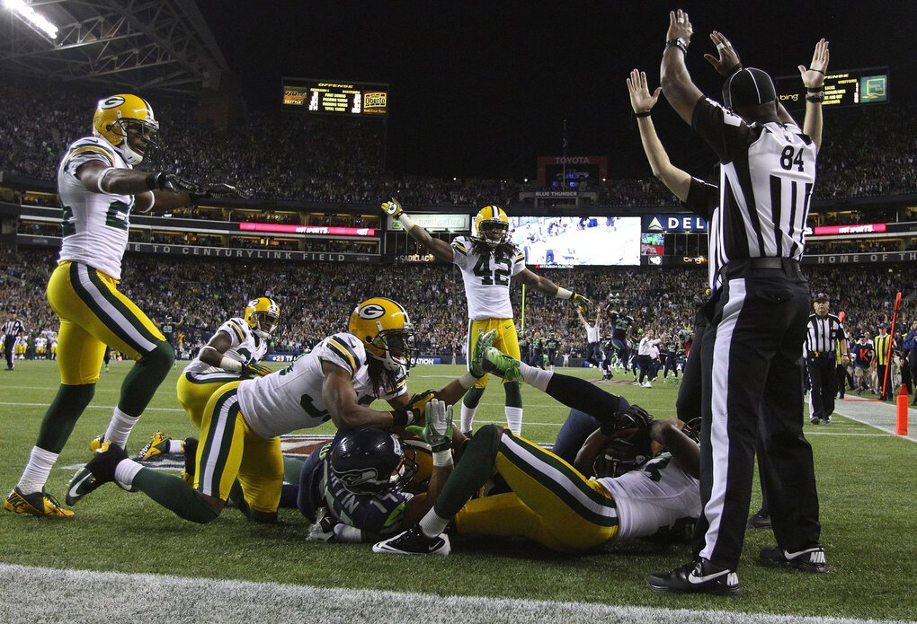 Referees call a touchdown after Seattle Seahawks wide receiver Golden Tate pulled in a last-second pass by Russell Wilson to defeat the Green Bay Packers at CenturyLink Field in Seattle, Washington, Monday, September 24, 2012. (John Lok / The Seattle Times)
