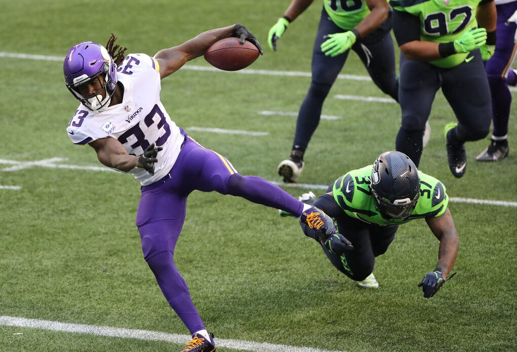 Vikings running back Dalvin Cook runs for a touchdown in the first quarter. (Dean Rutz / The Seattle Times)