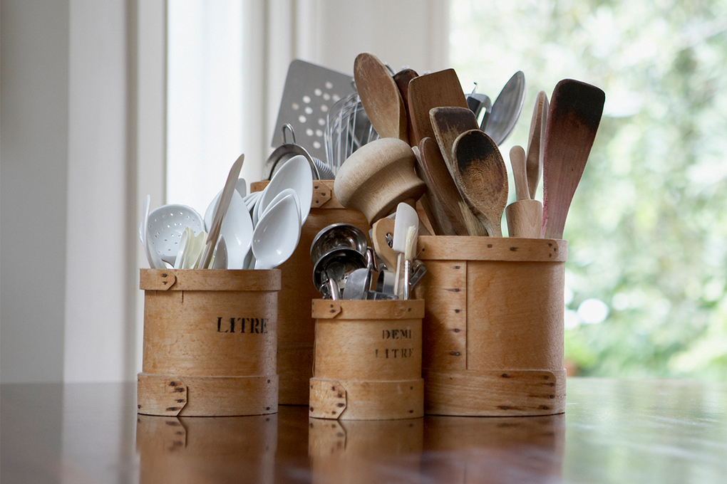 Employing a vase or other container to hold kitchen utensils means you won't need to open a drawer every time you need tongs or a spatula. (Getty Images)