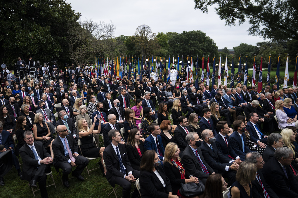 Staff and visitors listen as President Trump speaks with Judge Amy Coney Barrett during a ceremony to announce her as his nominee to the Supreme Court in the Rose Garden at the White House on Sept. 26. (Washington Post photo by Jabin Botsford).