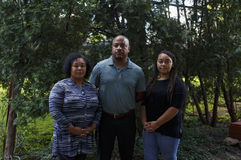 Nicoa Wells, left, 51, Merlin Wells, 48, and Payton Wells, 20, pose for a portrait outside their home in Southfield, Mich., on Sept. 4, 2020. (Photo for The Washington Post by Elaine Cromie).