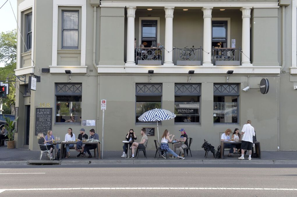 Customers outside of a bar in the Fitzroy district of Melbourne, Australia, on Wednesday, Oct. 28. (Bloomberg)